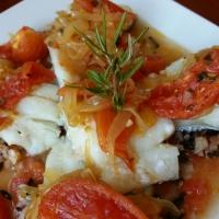 Bacalao al romero con confitura de tomate.